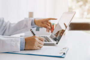 A physician using in-workflow services to enroll patients